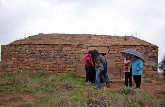 Aquí, la pluja ens va fer plegar.