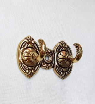 Alzapaño doble dorado 7,5 cm - 2