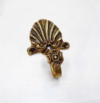 Alzapaño dorado concha 9 cm - 2