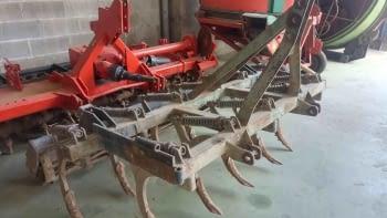 Cultivador de 11 brazos con muelles